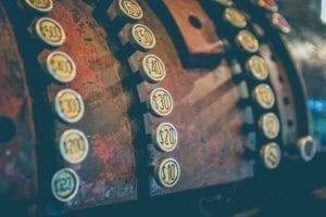 a closeup photo of vintage cash register buttons