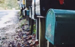 a closeup photo of a row of mailboxes