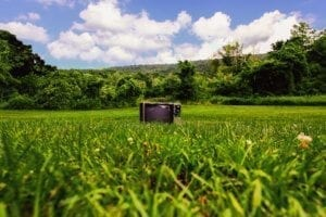 a photo of a television in a grassy field