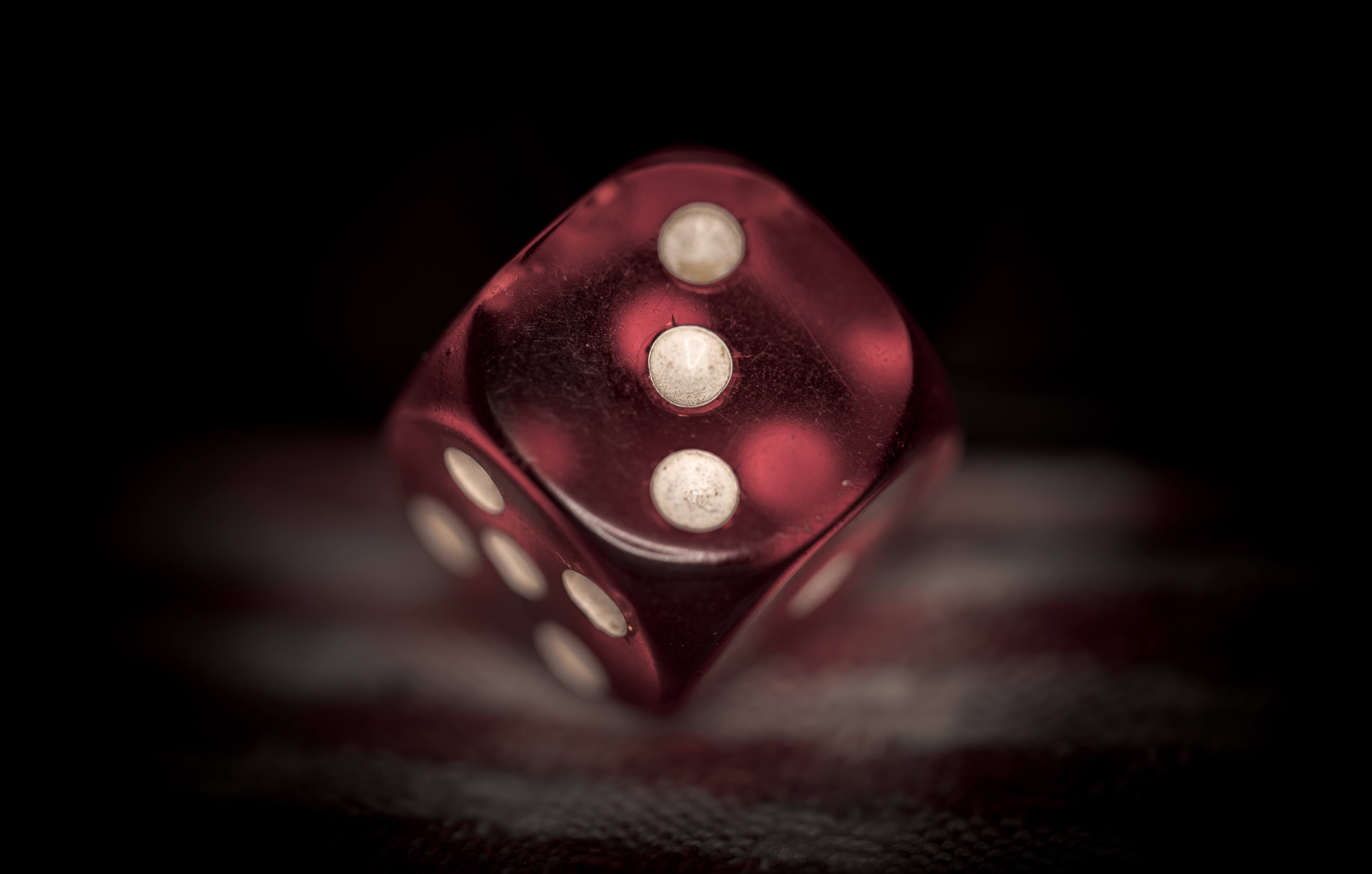 a single red die showing the number 3