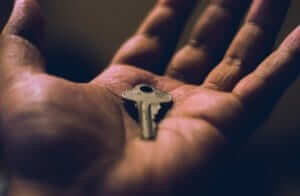 closeup of a hand holding a key