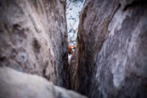 a person rock climbing in a crevasse