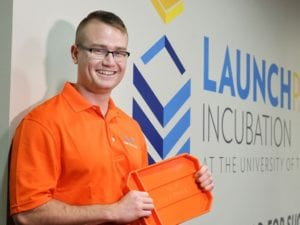 Tom Burden (holding a grypmat) at Launch Incubation event